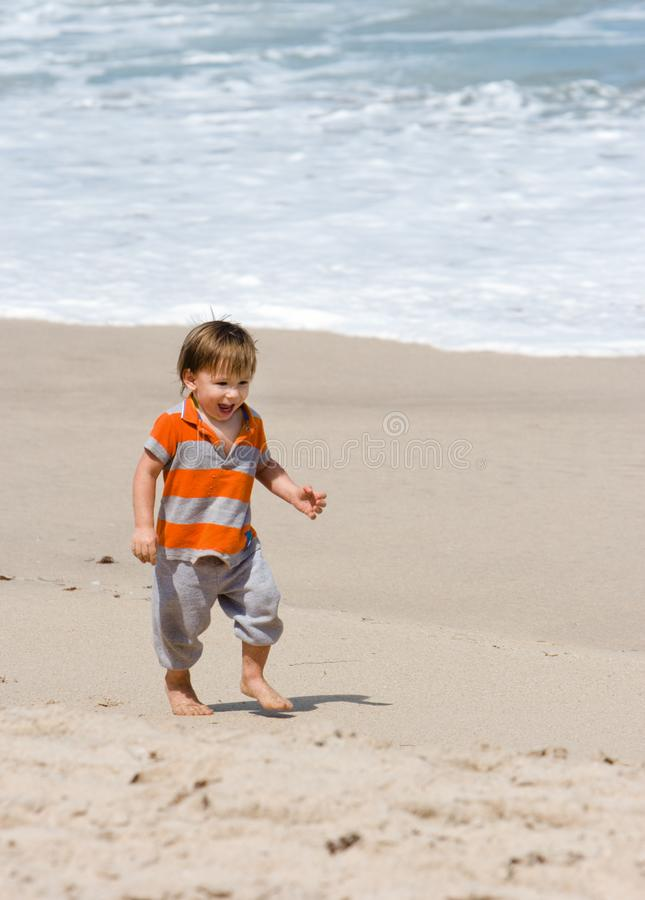 Toddler on Beach stock photography