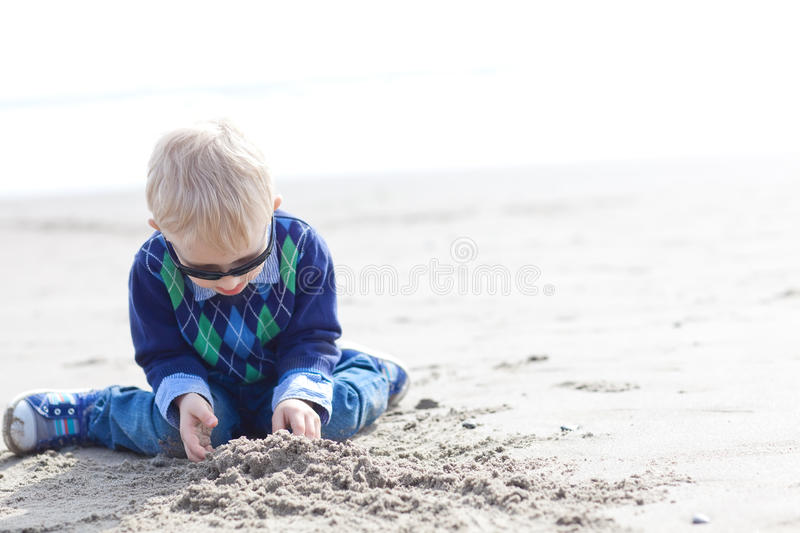 Toddler at the beach stock photography