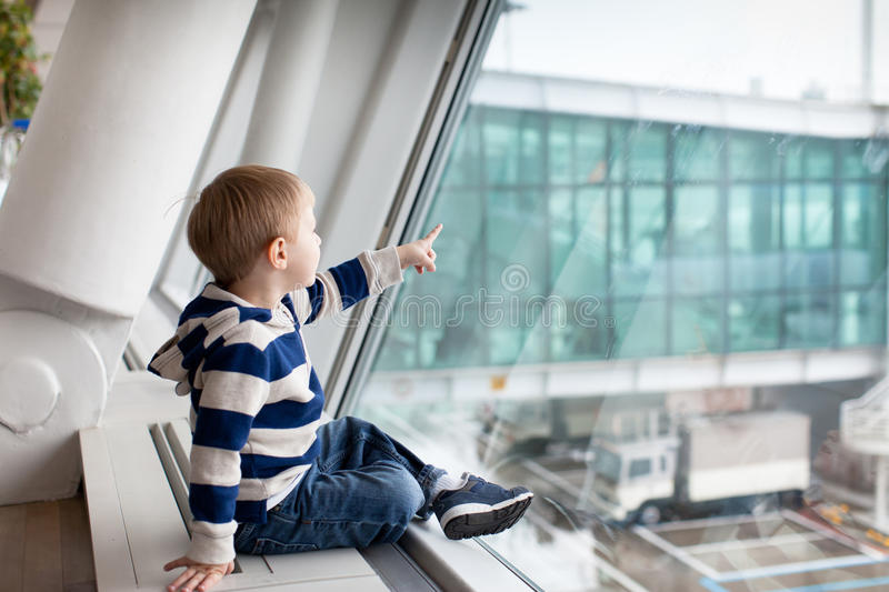 Toddler boy at the airport stock image