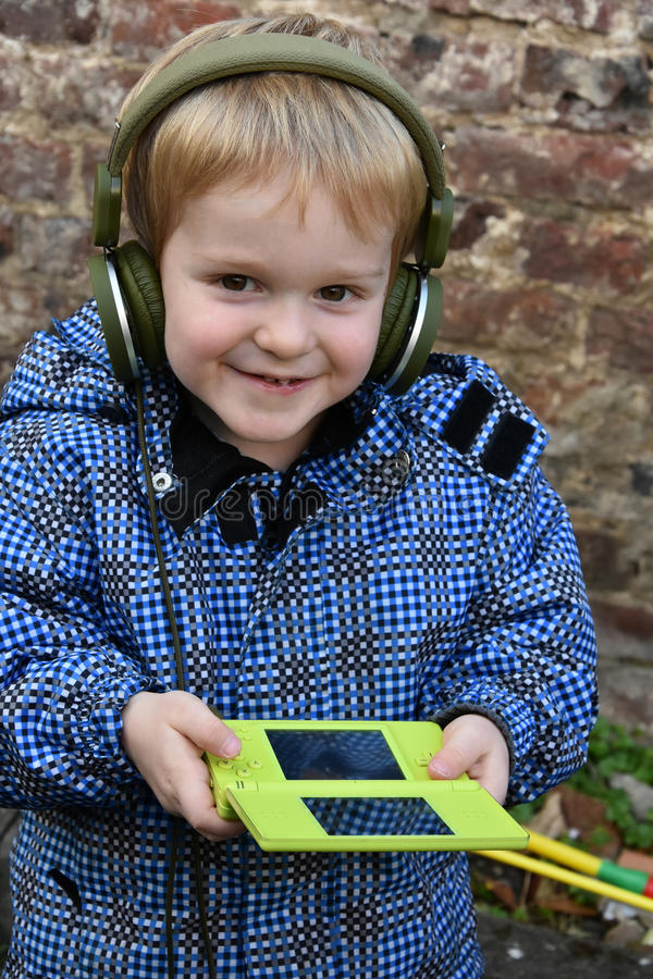Toddler boy with console game royalty free stock images