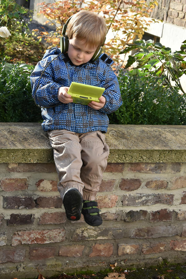 Toddler boy with console game royalty free stock photos
