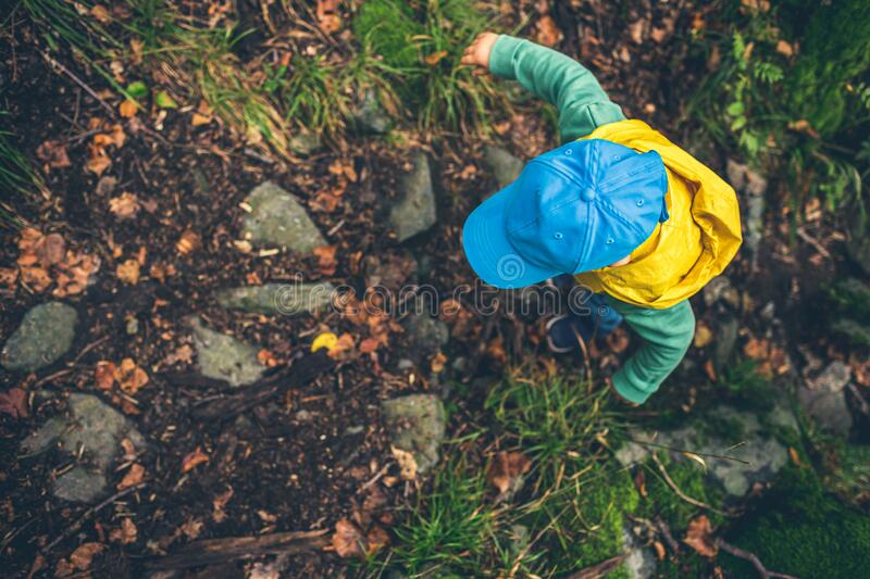 Toddler boy hiking in mountains stock images