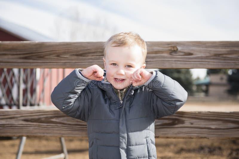 Toddler Boy at a Local Urban Farm Enjoying the Day, Smiling & La. Ughing stock photo