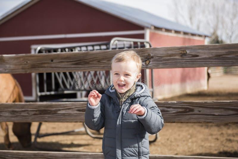 Toddler Boy at a Local Urban Farm Enjoying the Day, Smiling & La. Ughing royalty free stock photography