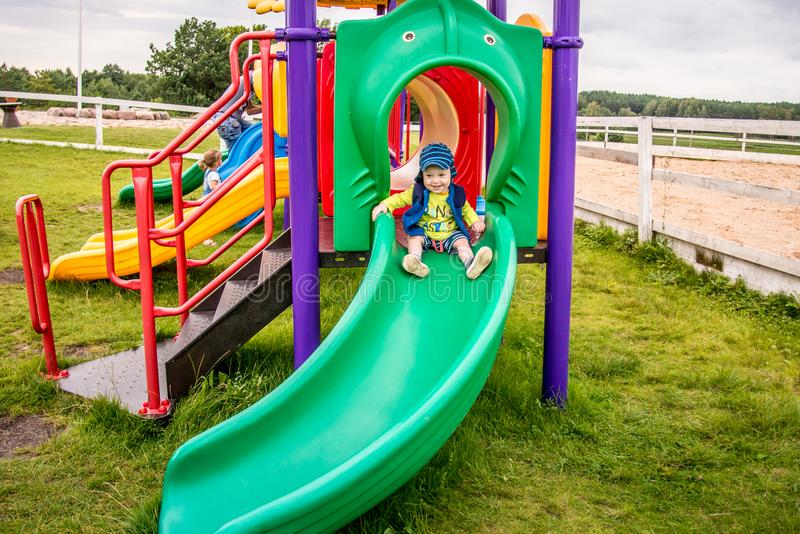 Toddler boy at playground. Active boy at outdoor playground, happy childhood royalty free stock photos