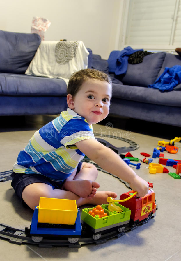 Toddler boy playing with lego royalty free stock image