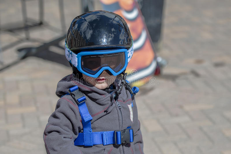 Toddler Boy Ready to Ski with all Safety Gear. Helmet & Harness. stock photography