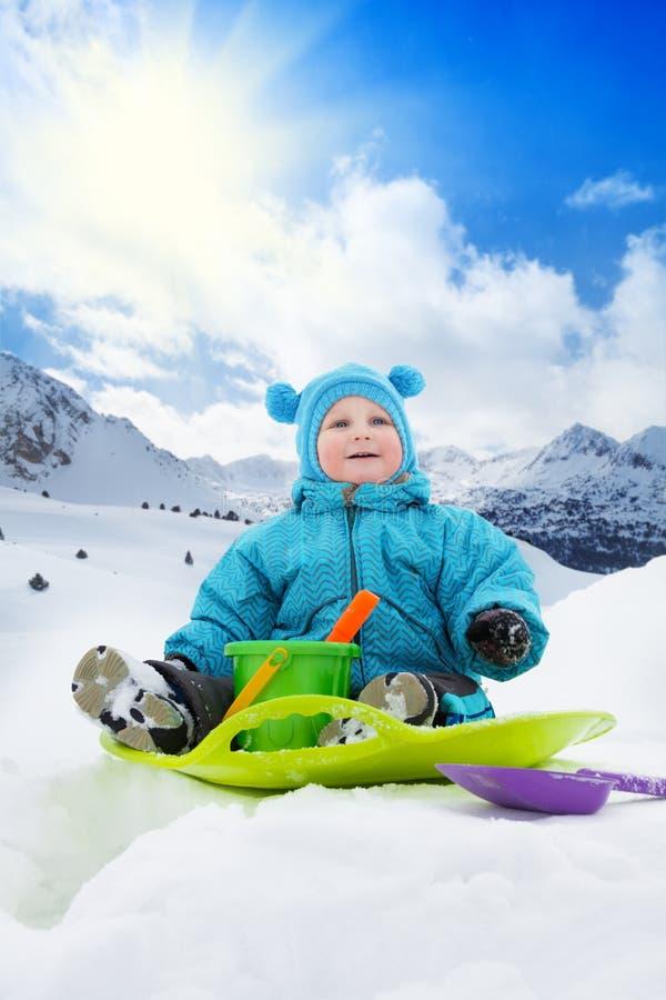 Toddler boy and sledge stock photos