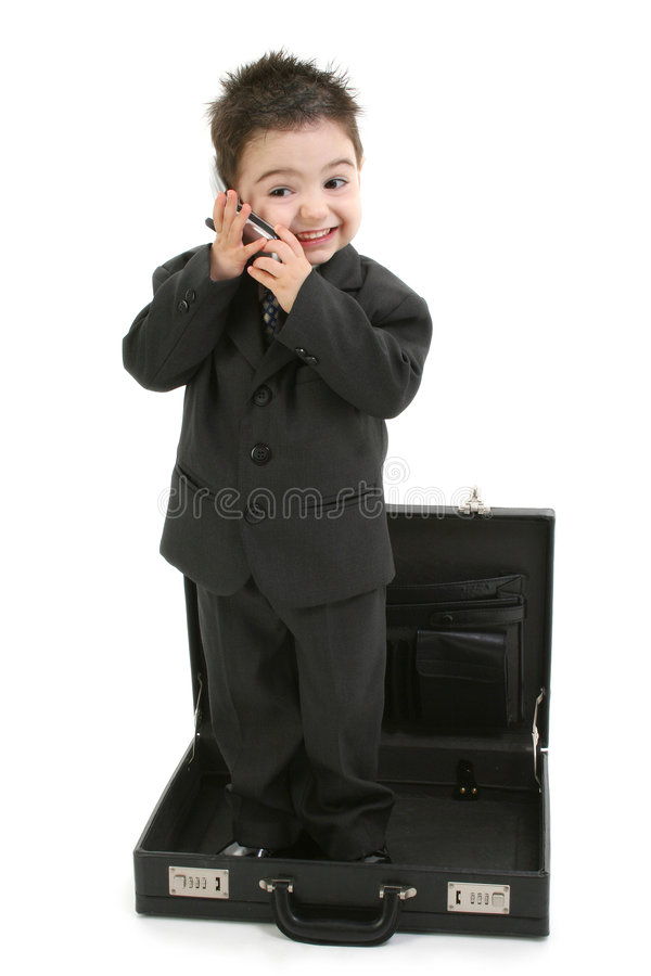 Toddler Boy in Suit Standing in Briefcase stock photo