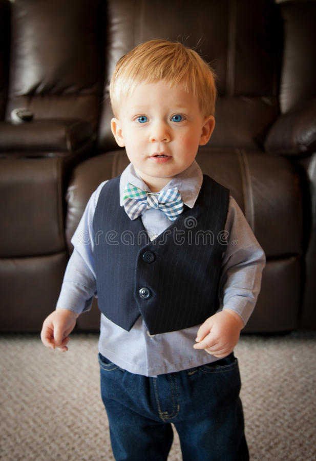 Toddler boy wearing bow tie and suit vest. Toddler boy dressed up in a suit and tie royalty free stock photography