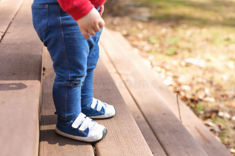 Toddler boy wearing sneakers outside stock photography