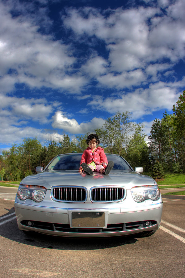 Download Toddler on the car stock image. Image of automobiles, clouds - 5399499