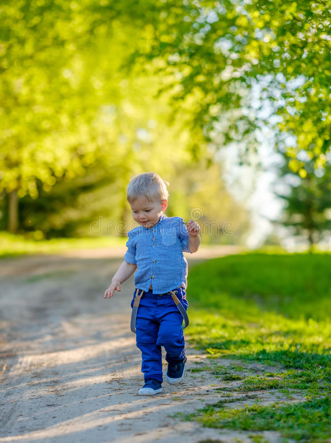 Toddler child outdoors. Rural scene with one year old baby boy royalty free stock image