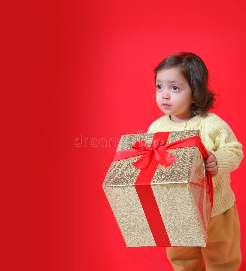 Toddler with a christmas gift royalty free stock image