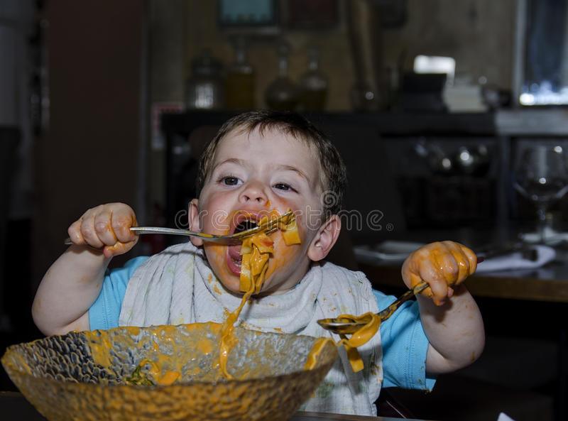 Toddler covered with pasta royalty free stock image