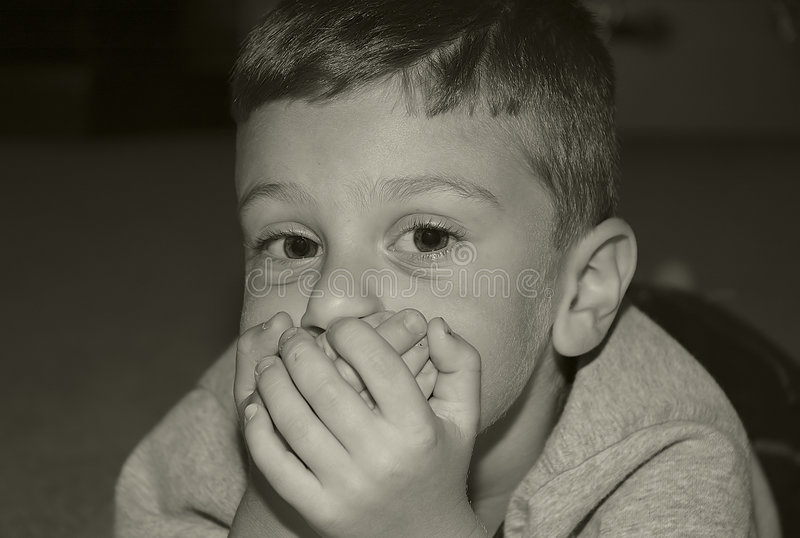 Toddler Covering Mouth royalty free stock image
