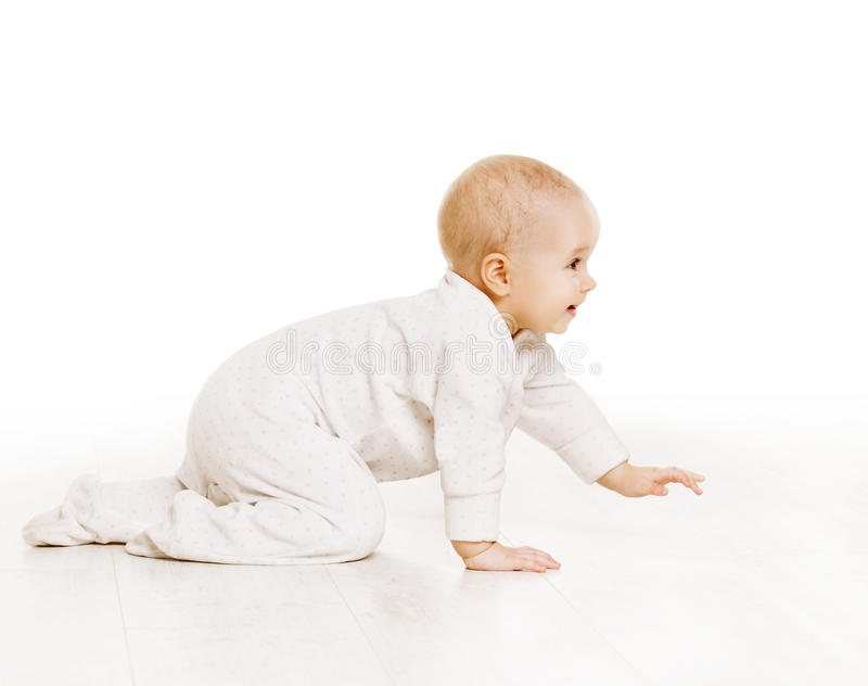 Toddler Crawling in White Baby Onesie, Kid Creeping, White. Toddler Crawling in White Baby Onesie, Active Kid Creeping on all fours over White Background stock image