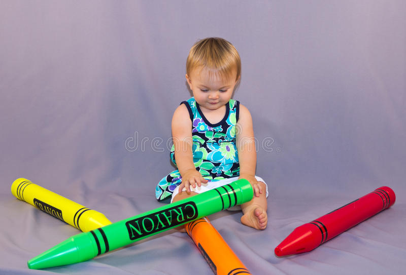 Toddler and crayons royalty free stock photo