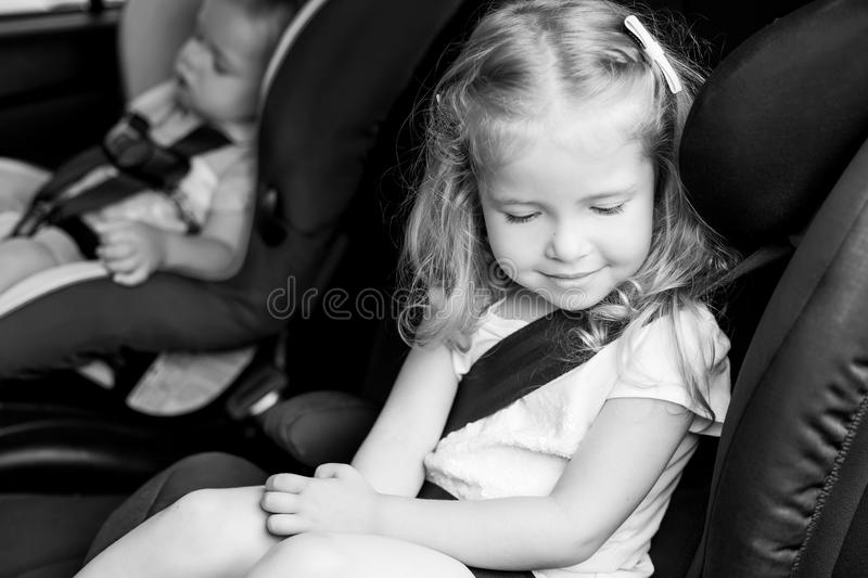 Toddler cute kids in car seats. Summer ( black and white royalty free stock image