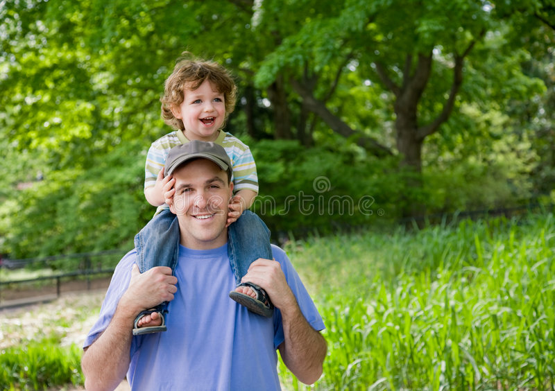 Toddler on Dad s shoulders.