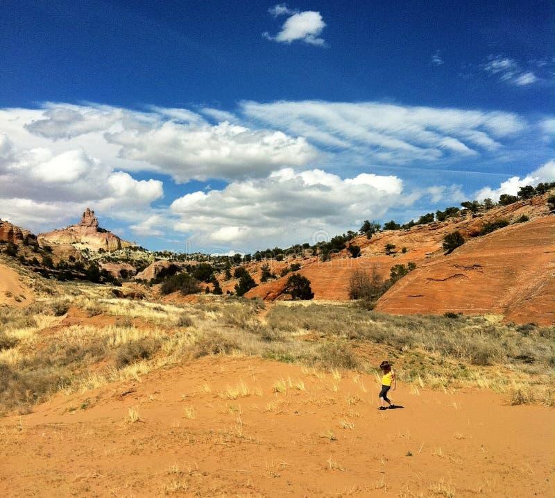 Toddler running in desert. Female toddler running through desert in Red Rock Park, New Mexico, U.S.A royalty free stock image