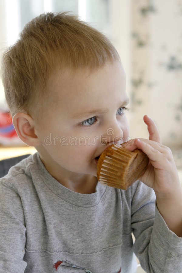 Toddler Eating a Muffin royalty free stock photography