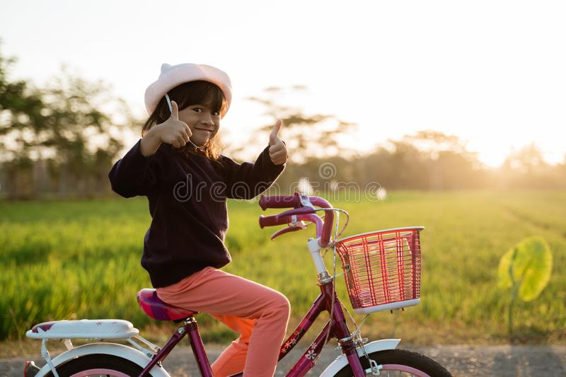 Toddler enjoy riding her bicycle outdoor royalty free stock image