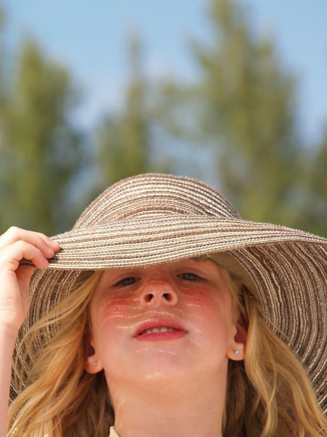 Toddler in floppy sun hat stock image