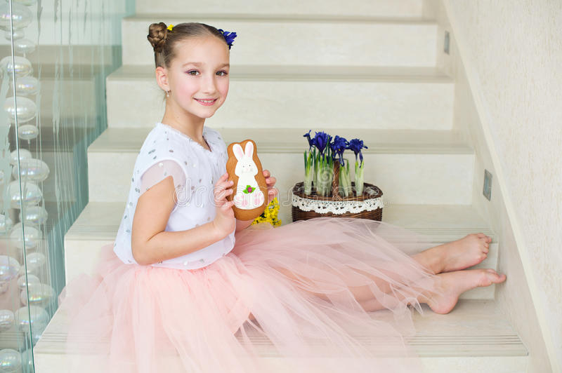 Toddler funny ballerina girl at home ready to celebrate spring a stock photo