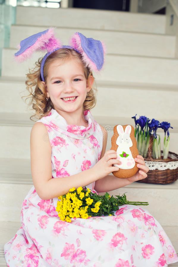 Toddler funny girl with bunny ears at home ready to celebrate sp stock photos
