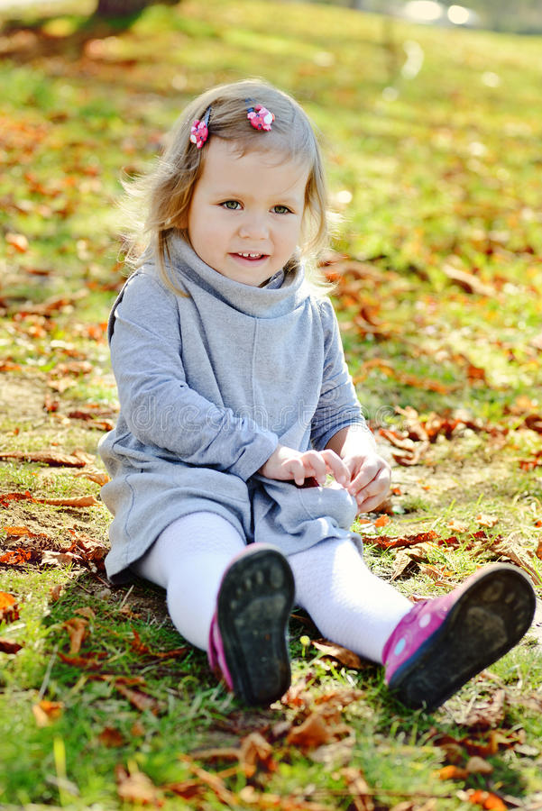 Toddler girl in autumn park stock image