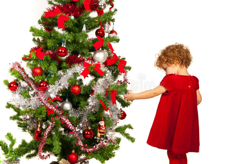 Download Toddler Girl Decorate Xmas Tree Stock Photo - Image: 34587930