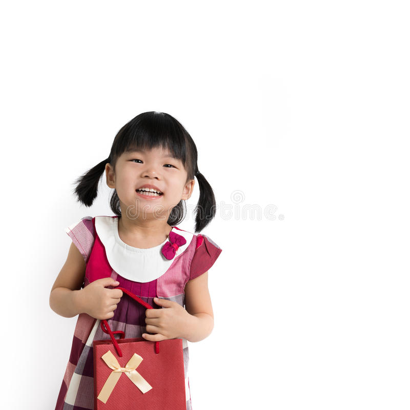 Toddler Girl With Gift Bag Stock Images