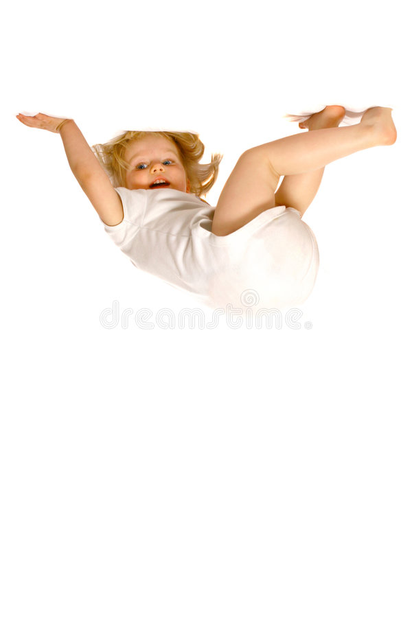 Toddler girl hanging upside down royalty free stock photos