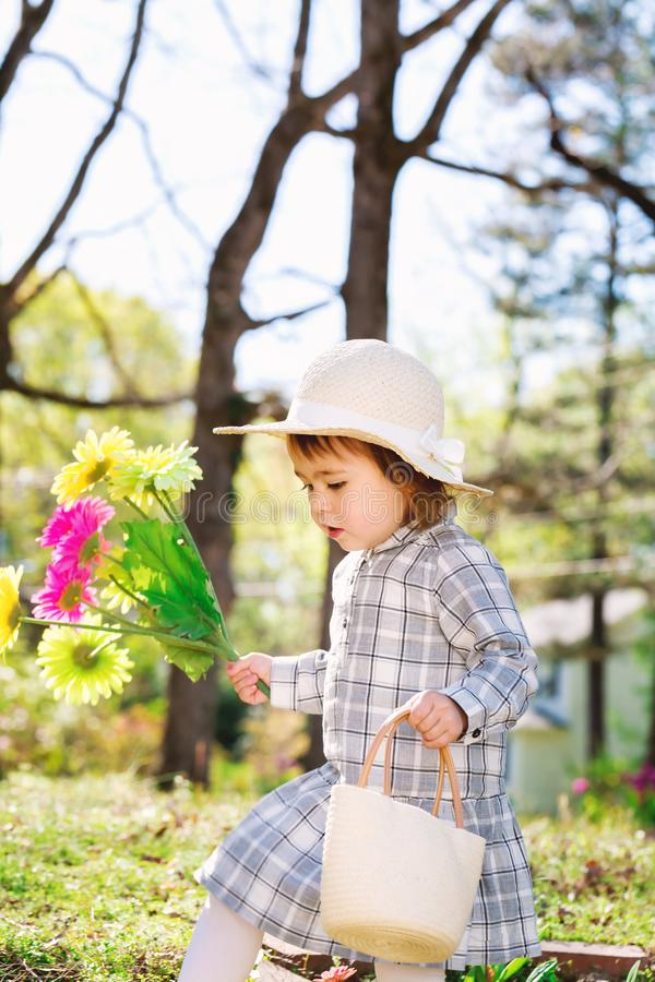 Toddler girl playing outside stock photos