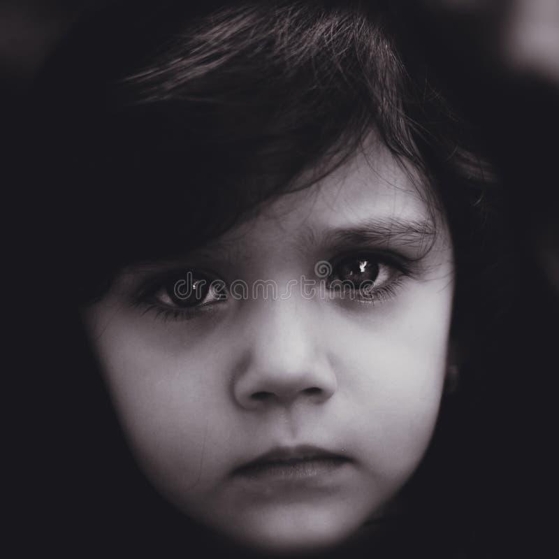 Toddler girl looking sad at the camera stock photography