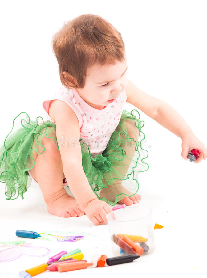 Toddler girl paints on the paper royalty free stock photo