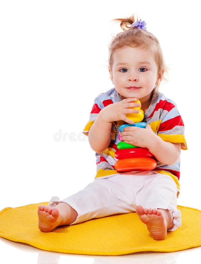 Toddler girl playing royalty free stock photo