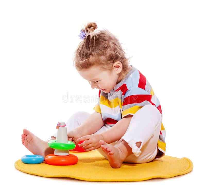 Toddler girl playing stock photos