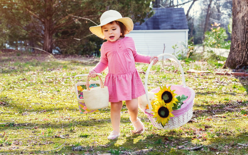 Toddler girl playing outside with an easter basket stock photo download toddler girl playing outside with an easter basket stock photo image of person negle Image collections