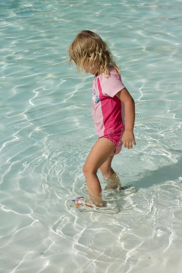 Toddler Girl playing in the pool royalty free stock images