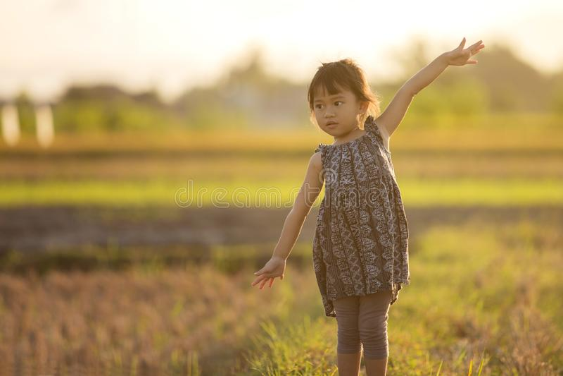 Toddler girl pretend role play as a pilot royalty free stock photos