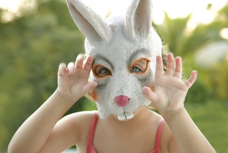 Toddler girl with rabbit white mask stock images