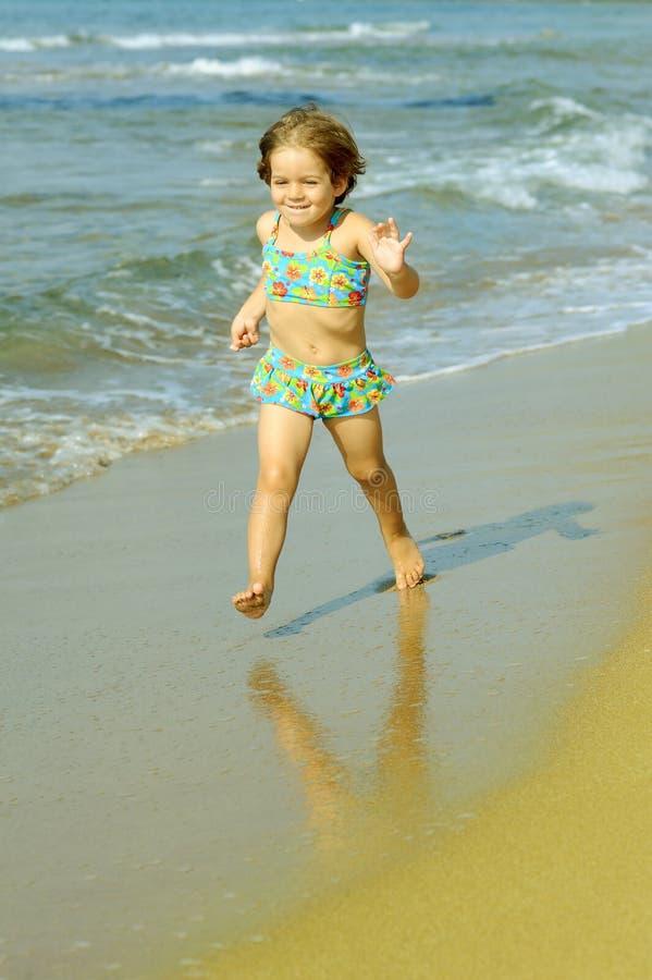 Download Toddler Girl Running At Beach Stock Photo - Image: 28933602