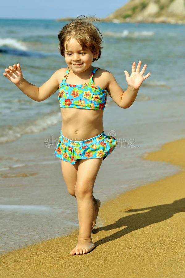 Toddler Girl Running At Beach Royalty Free Stock Photography
