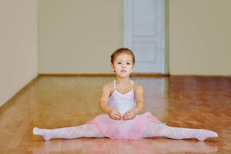 Toddler girl sitting in cross split stock image