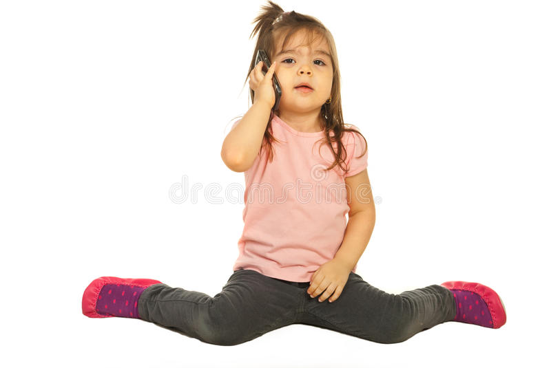 Toddler Girl Speaking By Phone Mobile Royalty Free Stock Photos