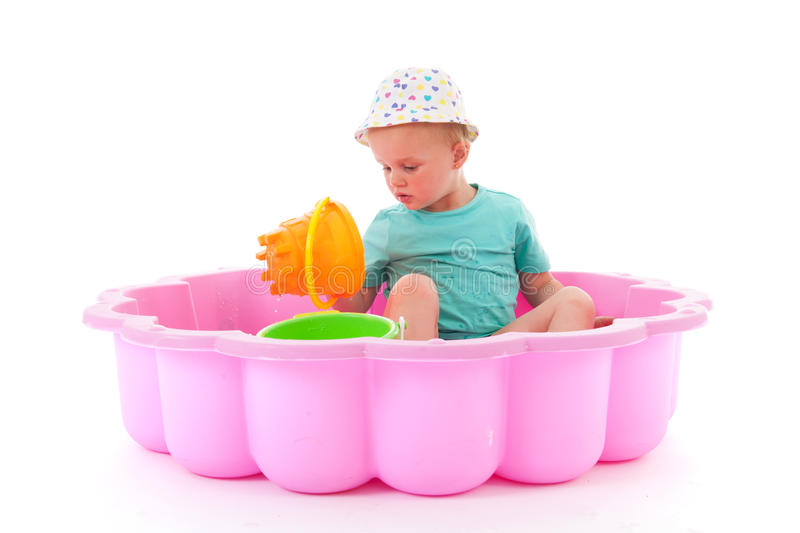 Toddler girl in swimming pool stock photos