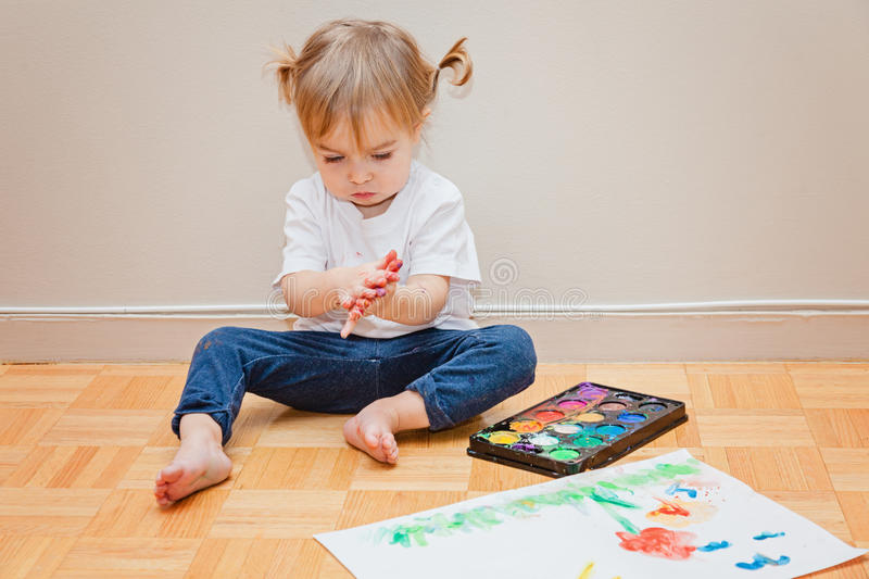 Toddler girl and watercolors. Early learning, art. royalty free stock photos