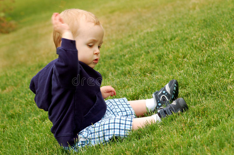 Toddler in the grass royalty free stock photos